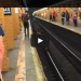 Guy Tries To Long Jump Over Subway Track And Fails Hard