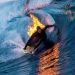 Surfer Sets Himself On Fire And Rides Through A Skull Crushing Wave