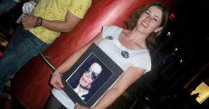 woman holding picture of michael jackson