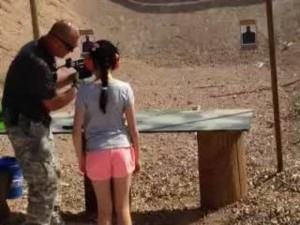 girls shoots instructor with uzi