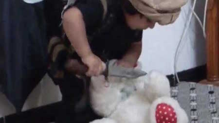 ISIS-kid-taught-to-behead-teddy-bear2