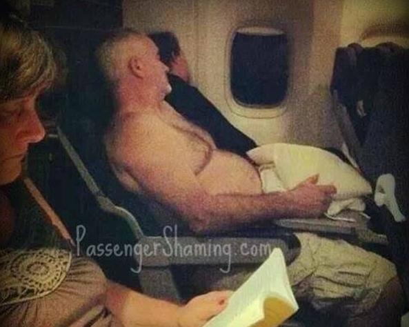 fat old man sleeping shirtless on plane